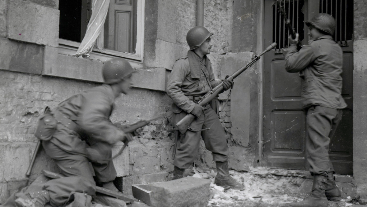 Three Americans of the 117th Inf Regt. about to storm a house held by German troops in Stavelot, Belgium, 21st December, 1944