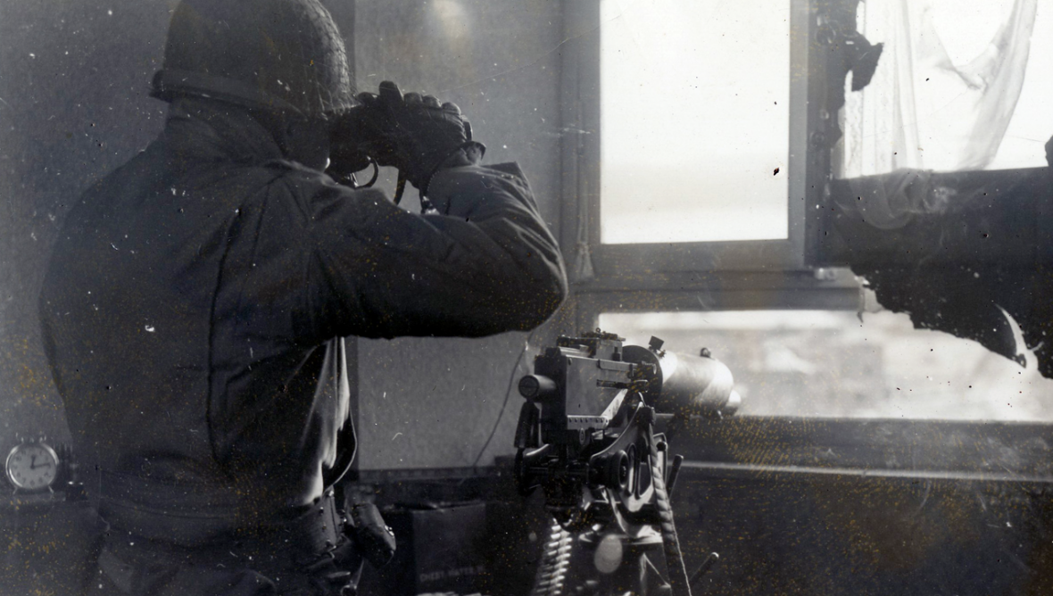 Pvt. Roy McDaniels, Hartford City, Ind., keeps a look out for enemy activity in Stavelot, Belgium
